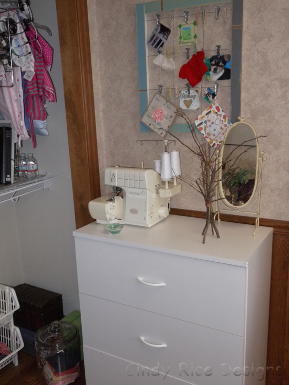 Here's the little dresser which now gives me a place to put my serger.  :)